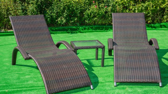 Two Rattan Sun Loungers And Table Only £149
